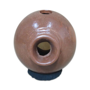 The Udu is made entirely of clay (terracota), in the form of a narrow necked, vase-like vessel. Reminiscent of tablas or talking drums.